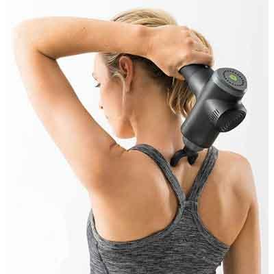 Image of a woman using Beurer MG 180 on the back of the neck