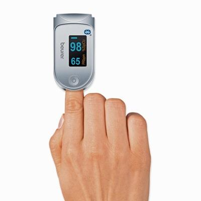 Beurer PO 60 Pulse Oximeter on a fingertip