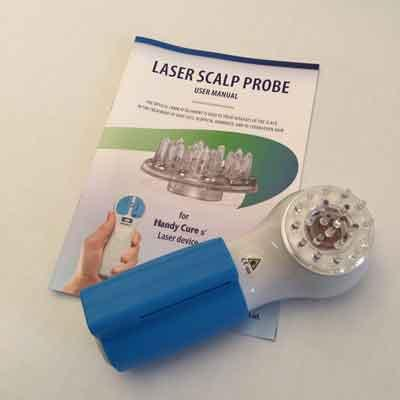 Image of the Handy Cure s' laser with scalp probe and user manual