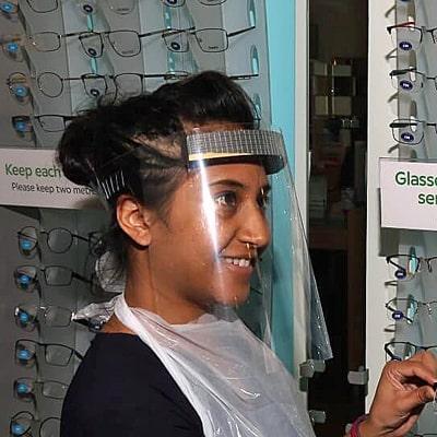 Image of an optician wearing Medi 1st Visor