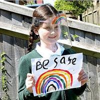 Image of a girl wearing Kidsafe Visor and be safe rainbow poster