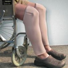 Image of DermaSavers Shin and Knee Protectors worn by wheelchair user