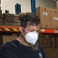 Image of a factory worker wearing 1st Defence Visor