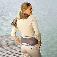 Image of a lady wearing Beurer Heat To Go heated belt